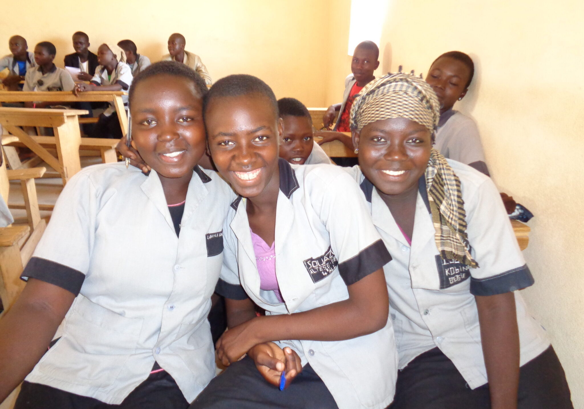 A group of students sitting together and smiling