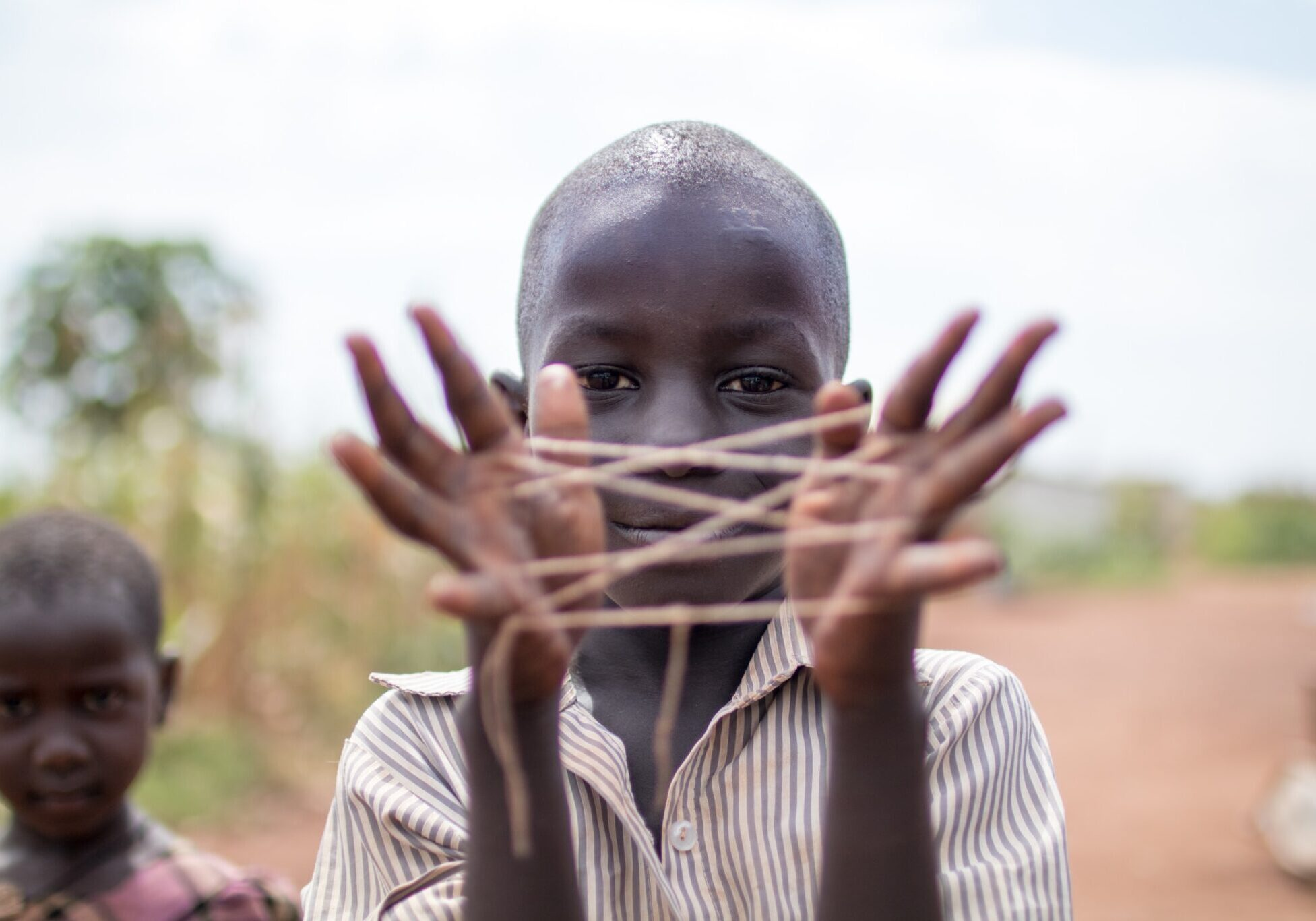 boy with hand string